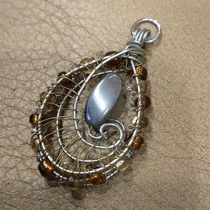 🇨🇦 Hematite Swirl Pendant